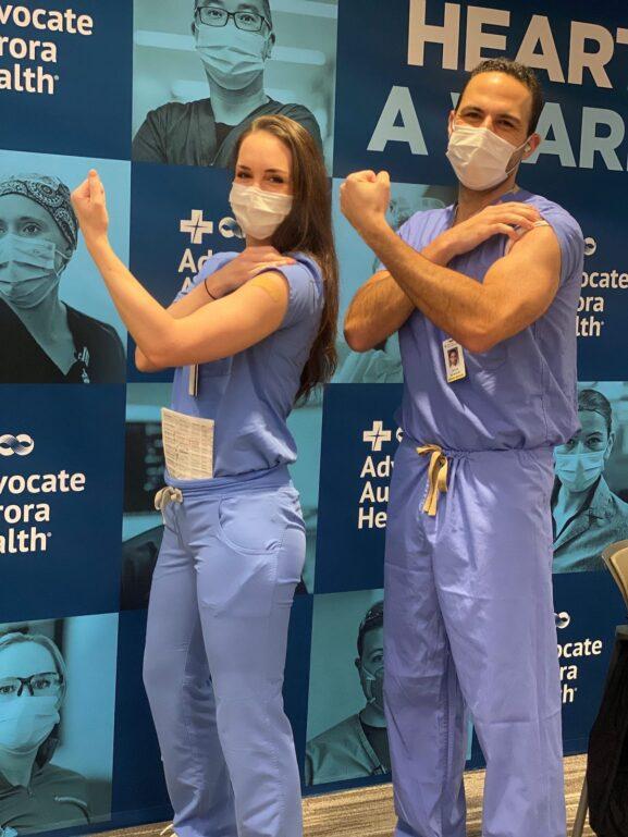 Alicja Salman flexes with another doctor